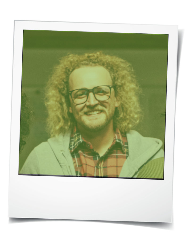 Polaroid-style photo of young white man with curly hair and glasses